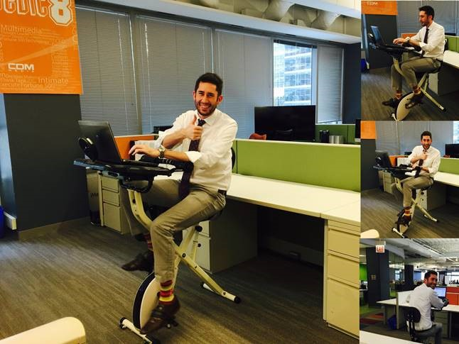 IT Support guru, Bennett Baker, tests out one of the new four Fit Desks.